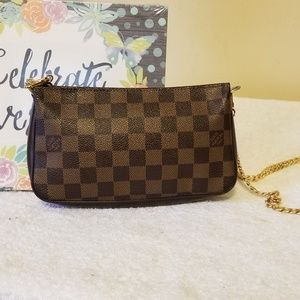 LV navona pochette authentic